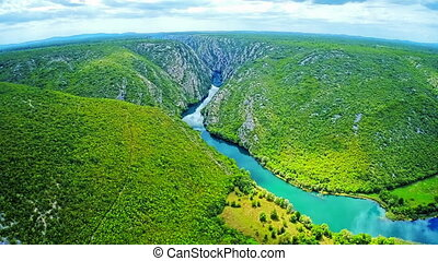 Krka river flow - aerial - Copter aerial view of the Krka...