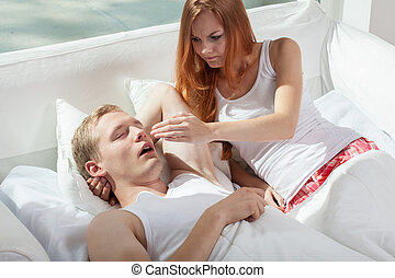 Woman irritated by snoring husband - Image of woman...