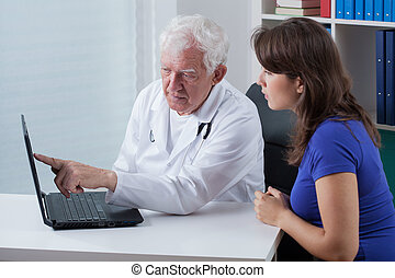 Doctor and patient looking at the laptop