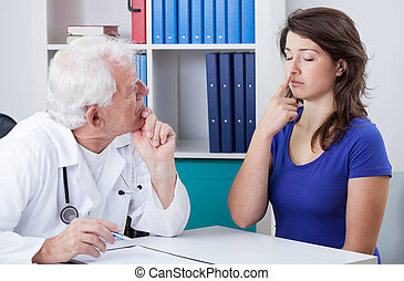 Physician diagnosing patient - Male physician diagnosing...