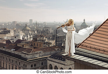 Woman playing the violin on the top of the edge of the roof...