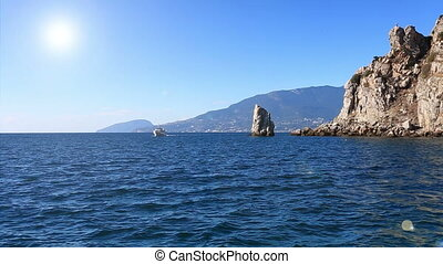 walking ship floats by Parus Rock in Yalta Crimea