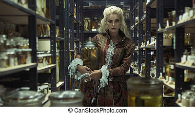 Blond attractive woman in the retro laboratory