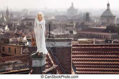 Blonde standing on the chimney with the violin - Blonde...
