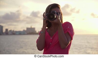 Young woman photographer photo - Portrait of young beautiful...