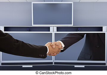 Businessman handshake on video conference screen