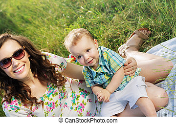 Beautiful woman with her cute son