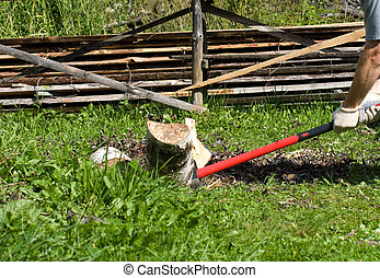 Cabin of fire wood - Axe with the red handle, splitting a...