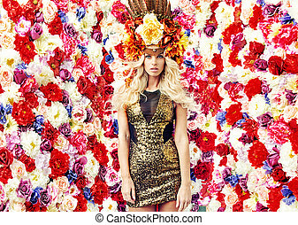 Sensual lady over the flower wall background