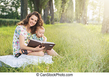 Charming mother spending spare time with her son - Charming...