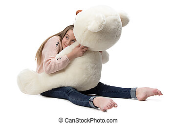 Image of girl hugging teddy bear on white background