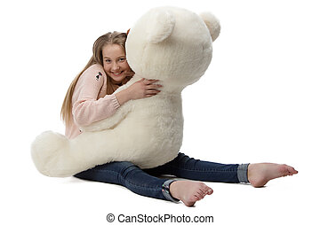 Portrait of girl hugging teddy bear on white background