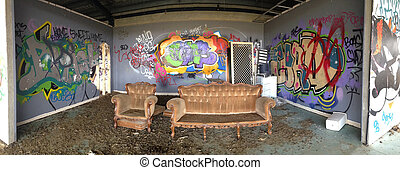 Abandoned urban building with graffiti and willful damage. Panor