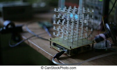 Cube of LEDs in the dark - Cube of LEDs, a scientist...