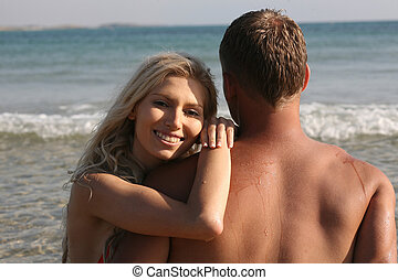 Lovely young female sitting with her boyfriend