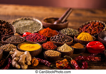 Wooden table of colorful spices - Traditional oriental...