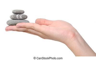 stones on a hand - balancing stones on a hand isolated on...