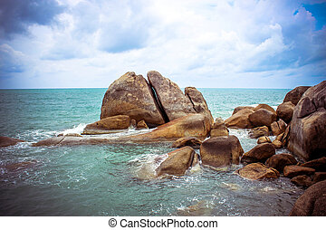 Sea waves crashing against the rocks, Koh Samui Thailand