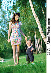 Mom walking with her cute son