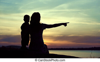Dark silhouettes of the mother with child - Dark silhouettes...