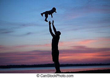 Silhouettes of father tossing his child - Sil