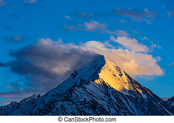 Snowcapped top of mountain in Himalayas - Snowcapped summit...