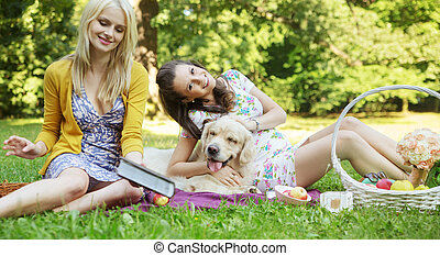 Young women playing with dog
