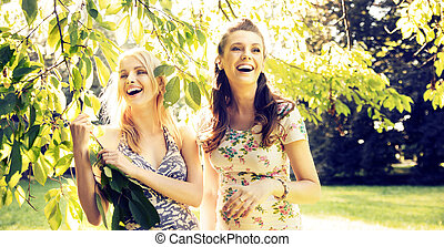 Portrait of the laughing girlfriends - Portrait of the two...