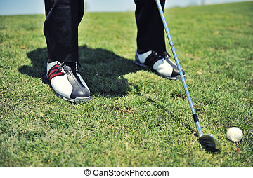 Golf shoes close up on course - Golf shoes of golfer on golf...