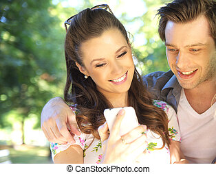 Couple textong to their friends - Couple textong to their...