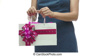 Female Torso Holding Pink Gift Bag - Torso of an anonymous...