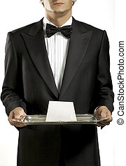 Waiter with black tie - Waiter with black bow tie holding a...