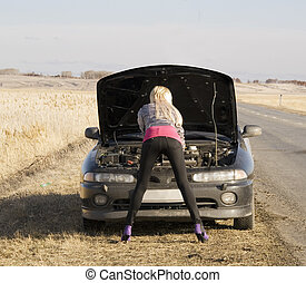 broken car - young pretty woman with her broken car