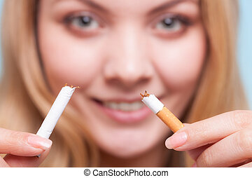 Addiction. Girl breaking cigarette. Quit smoking. -...
