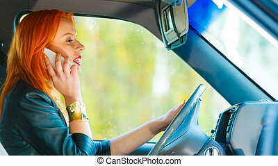 girl talking on mobile phone while driving the car. -...