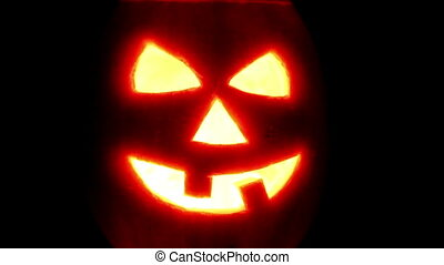 Halloween pumpkin jack-o-lantern candle lit, isolated on...