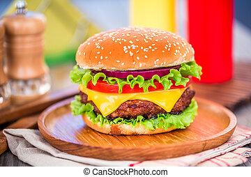 Burger - Tasty and appetizing hamburger cheeseburger