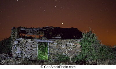 Ruined building night time lapse with plane trails - Time...