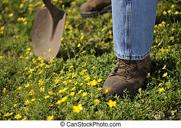 Work boots and shovel - Farmers work boots and shovel close...