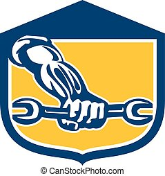 Mechanic Hand Holding Spanner Shield Retro
