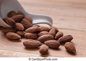 Almonds on wooden background - Almonds on rustic wooden...
