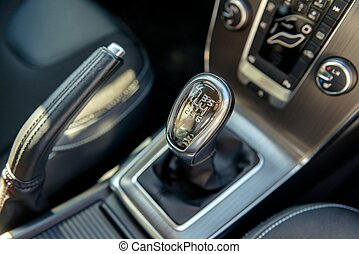 Closeup photo of car gearbox in bright light