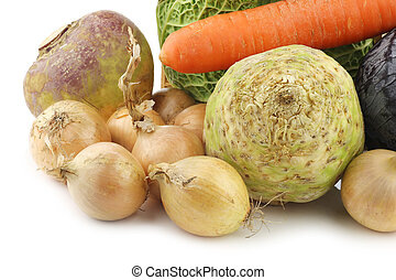 collection of many fresh winter vegetables on a white...