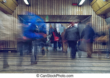 People at subway station - fast moving people at subway...