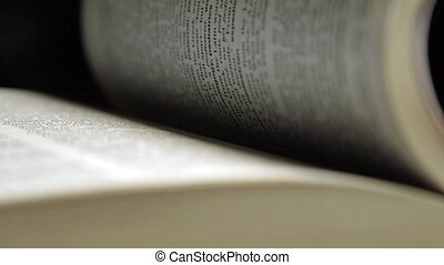 Turning the pages of book - Looking through a book turning...