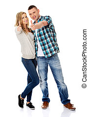 Couple showing thumbs up - Young attractive couple showing...