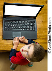 Boy working at a laptop