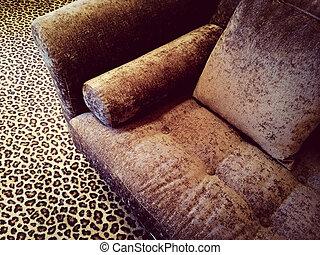 Velvet sofa on leopard carpet