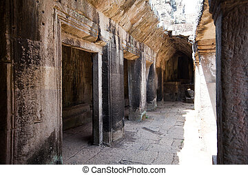 The ancient ruins of a historic Khmer temple in the temple...