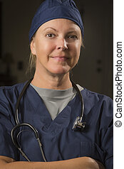 Attractive Female Doctor or Nurse Portrait Wearing...